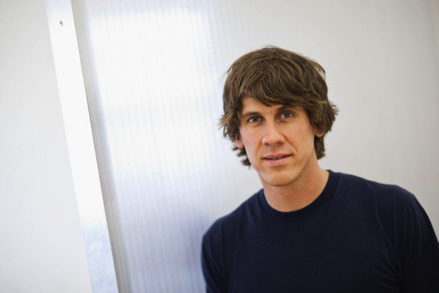 """05 Aug 2009, New York City, New York, USA --- Dennis Crowley, co-founder of social media website Foursquare, in their shared office in New York, USA, 5 August 2009. Foursquare, which allows users to stay connected to friends and explore a city, has been dubbed """"the next Twitter"""" by an influential tech blog. --- Image by © David Brabyn/Corbis"""